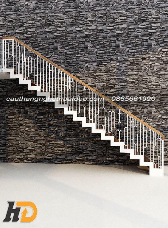 Lan can cầu thang được bài trí bằng sắt uốn tinh tế